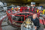 Helmholz Coils Unexpectedly Slow Growth of Magneto-Rayleigh-Taylor Instabilities