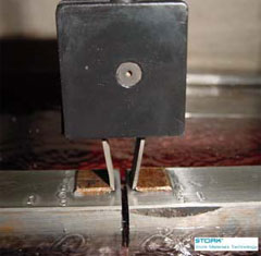 Use of a clip gage allows crack opening width to be measured.