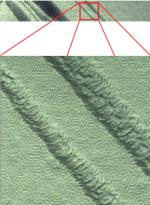 TappingMode+ height image and zoom of a copolymer. The square image is a zoom into the boxed area in the original rectangular image. This detail is revealed by simply zooming in with software and without the need for time-consuming, repetitive smaller scans. Without this higher resolution scanning, the zoomed image would not have the pixel resolution required to view nanoscale details
